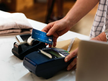 Blue credit card being used while shopping