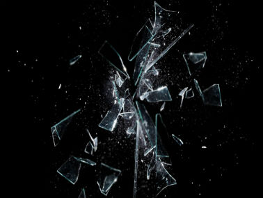 broken shards of glass in front of black background