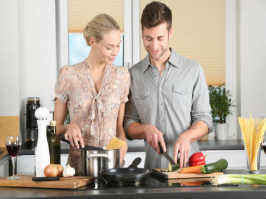 couple preparing a meal in kitchen together