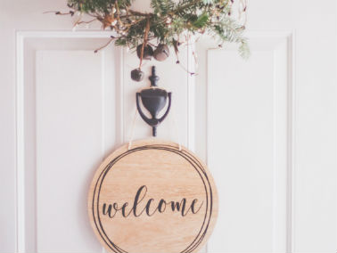 welcome décor on door