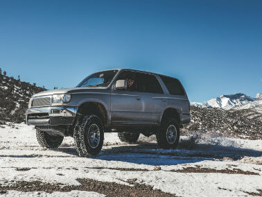 silver vehicle on a snowy mountain