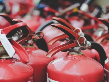 close up of group of fire extinguishers