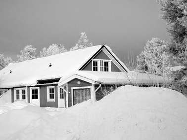 Home covered with snow