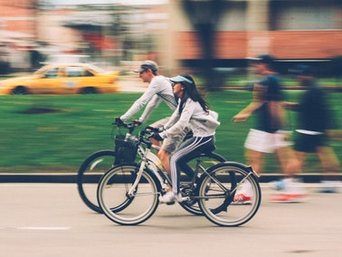 two people bike riding in the city
