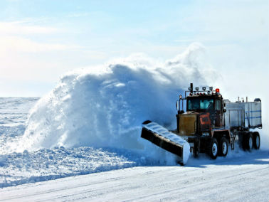snowplow clearing snow away