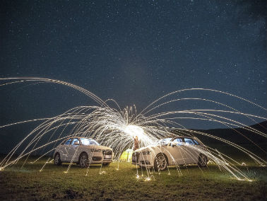 fireworks above two cars