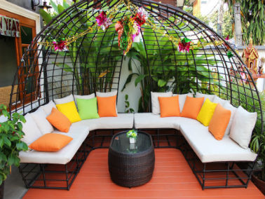 outdoor seating with bright pillows